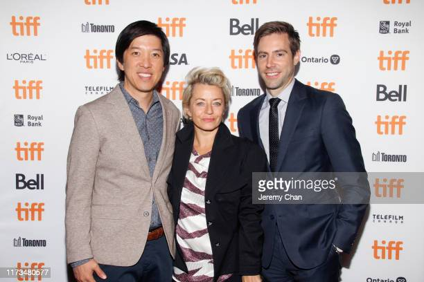 """Dan Lin, Tracey Seaward and Jonathan Eirich attend """"The Two Popes"""" premiere during the 2019 Toronto International Film Festival at Winter Garden..."""