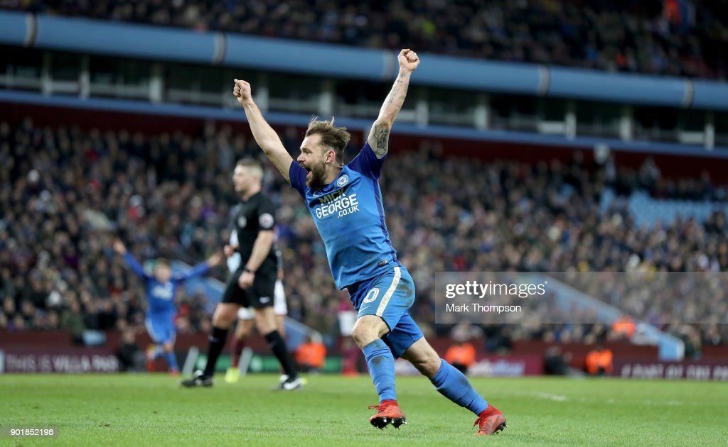 Dan Lloyd-McGoldrick of Peterborough United celebrates the goal scored by Jack Marriott of Peterborough United during The Emirates FA Cup Third Round match between Aston Villa and Peterborough United at Villa Park on January 6, 2018 in Birmingham, England.