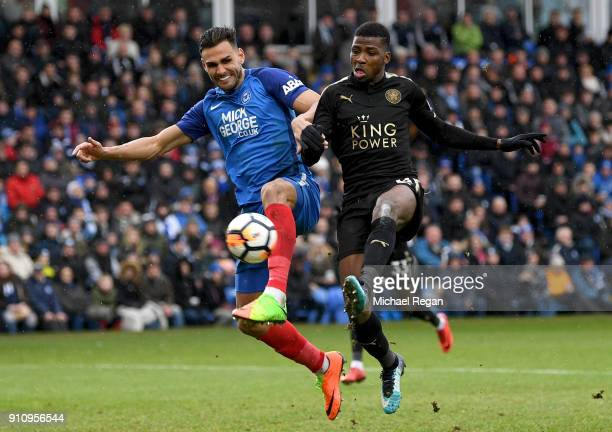 Dan LloydMcGoldrick of Peterborough United is challenged by Kelechi Iheanacho of Leicester City during The Emirates FA Cup Fourth Round match between...