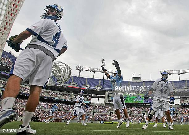 Dan Loftus of Duke looks into the goal while Steven Boyle of Johns Hopkins celebrates on May 28 2007 at MT Bank Stadium in Baltimore Maryland Johns...