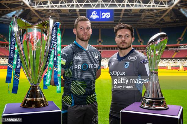 Dan Lydiate of Ospreys, and Ellis Jenkins of Cardiff Blues, pose with both trophies during the European Rugby Heineken Champions Cup and Challenge...