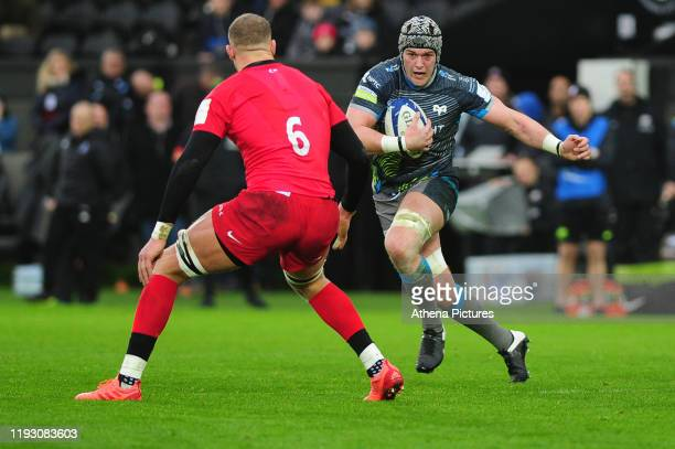 Dan Lydiate of Ospreys in action during the Heineken Champions Cup Round 5 match between the Ospreys and Saracens at the Liberty Stadium on January...
