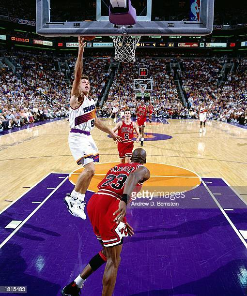 Dan Majerle of the Phoenix Suns drives to the basket for a layup against the Chicago Bulls in Game One of the 1993 NBA Championship Finals at America...