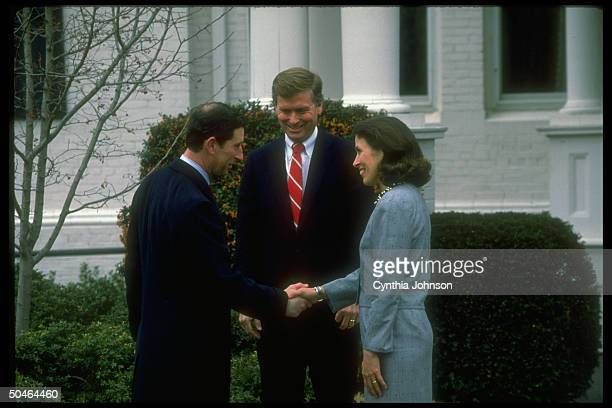 VP Dan Marilyn Quayle smilingly greeting their guest Prince Charles of Britain w handshake