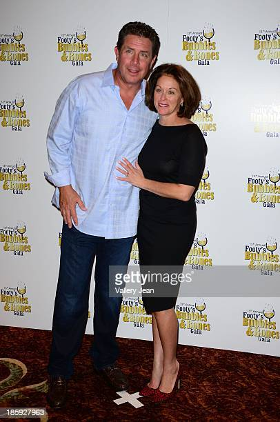 Dan Marino and wife Claire Marino attend the 13th Annual Footy's Bubbles Bones Gala at Westin Diplomat on October 25 2013 in Hollywood Florida