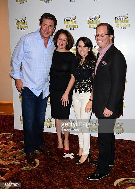 Dan Marino Claire Marino robin Levinson and Mark Levinson attend the 13th Annual Footy's Bubbles Bones Gala at Westin Diplomat on October 25 2013 in...
