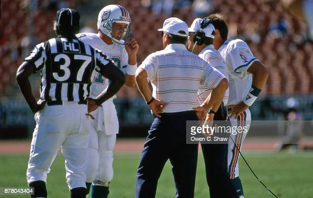 Dan Marino of the Miami Dolphins discusses strategy with Dolphins head coach Don Shula in a game against the Los Angeles Raiders at the Coliseum...