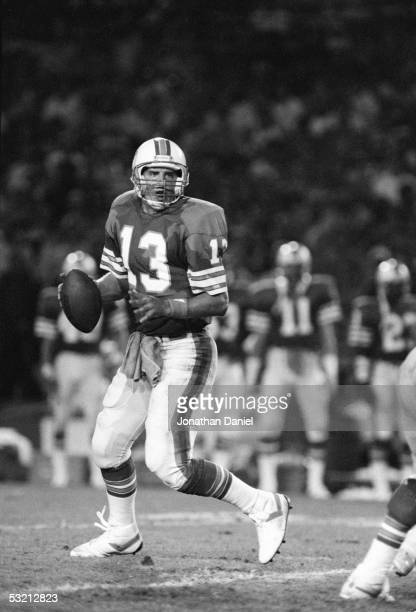 Dan Marino of the Miami Dolphins drops back to pass against the Chicago Bears during the game at the Orange Bowl on December 2 1985 in Miami Florida...