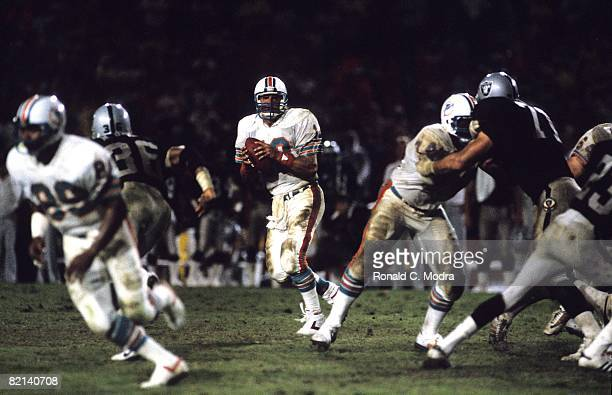 Dan Marino of the Miami Dolphins goes back to pass during a NFL game against the Los Angeles Raiders in the Orange Bowl on December 2 1984 in Miami...