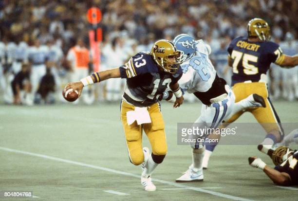 Dan Marino of the Pittsburgh Panthers scrambles away from the rush against the North Carolina Tar Heels during an NCAA football game September 9 1982...