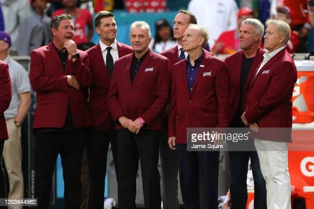 Dan Marino Tom Brady Joe Montana Peyton Manning Roger Staubach Brett Favre and John Elway of the NLF 100 AllTime Team are honored on the field prior...