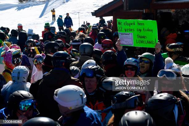 Dan Marinoble of Highlands Ranch, Colorado holds up a sign during the 29th Annual Valentine's Day Mountaintop Matrimony ceremony at Loveland Ski Area...