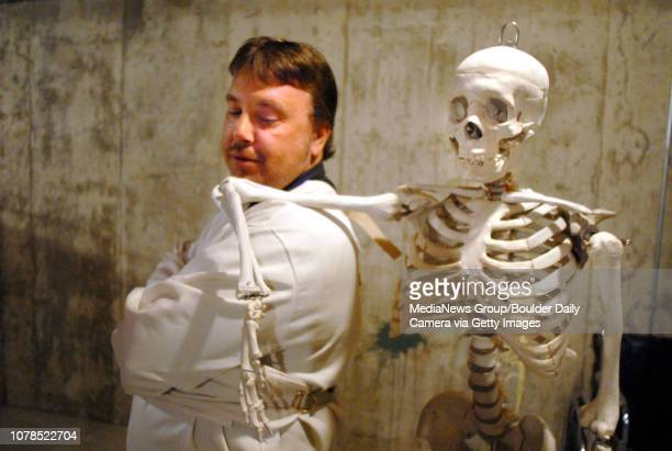 Dan Marquardt as Mark Styler in a straight jacket takes a break with a skeleton playing a former doctor during rehearsal of the Mind Game play at the...