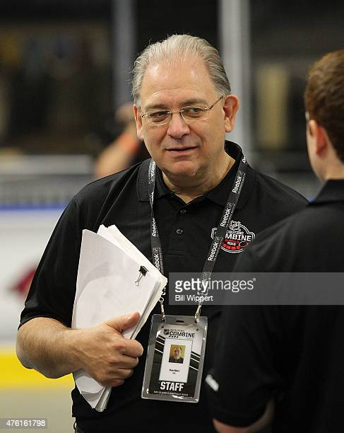 Dan Marr Director of NHL Central Scouting chats with staff during the NHL Combine at HarborCenter on June 6 2015 in Buffalo New York