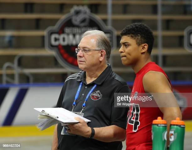 Dan Marr NHL Director of Central Scouting chats with Akil Thomas during the NHL Scouting Combine on June 2 2018 at HarborCenter in Buffalo New York