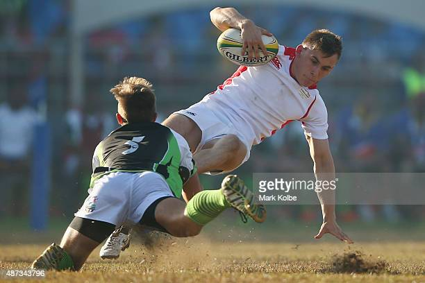 Dan Marshall of England is tackled during the boys match between England and Namibia in the rugby sevens competition at the Apia Park Sports Complex...
