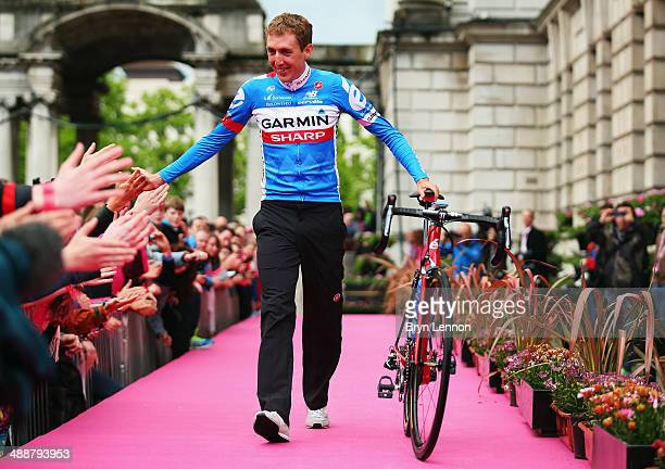 Dan Martin of Ireland and Team GarminSharp walks onto the stage during the Team Presentation for the 2014 Giro d'Italia on May 8 2014 in Belfast...