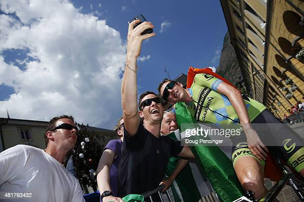 Dan Martin of Team Cannondale-Garmin greets fans before the start of Stage 19 of the 2015 Tour de France, a 138km stage between...