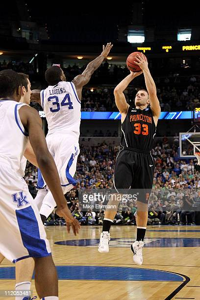 Dan Mavraides of the Princeton Tigers attempts a shot against the Kentucky Wildcats during the second round of the 2011 NCAA men's basketball...