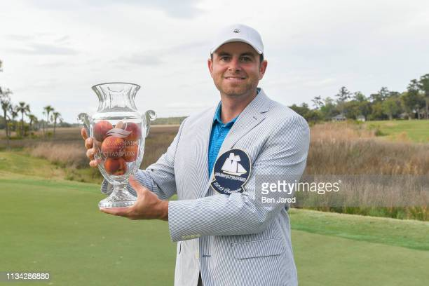 Dan McCarthy holds the Savannah Golf Championship tournament trophy on the eighteenth hole green after the final round of the Webcom Tour Savannah...