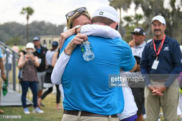 Dan McCarthy hugs his girlfriend by the eighteenth hole green during the final round of the Web.com Tour Savannah Golf Championship at the Landings...