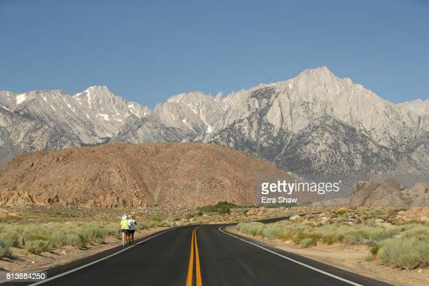 Dan McHugh runs to the Whitney Portal with a member of his support crew during the STYR Labs Badwater 135 on July 12 2017 in Death Valley California...