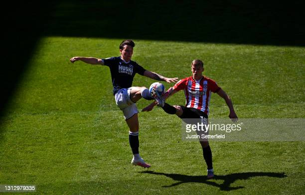 Dan McNamara of Millwall FC battles for possession with Marcus Forss of Brentford during the Sky Bet Championship match between Brentford and...