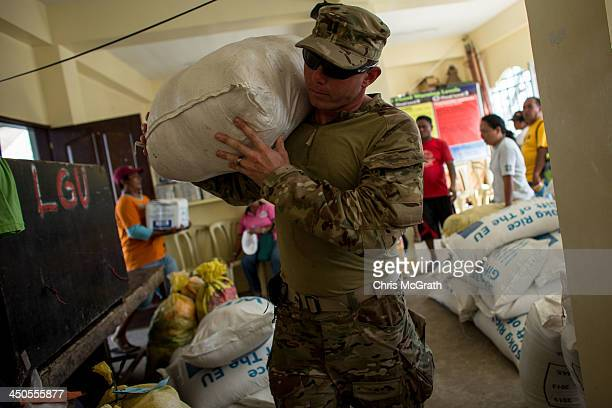 Dan Medford of the US Green Berets unloads a relief package at a distribution center on November 19 2013 in Leyte Philippines Typhoon Haiyan which...