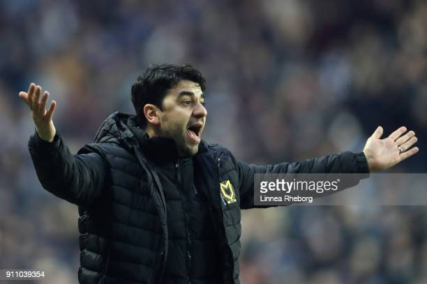 Dan Micciche Manager of Milton Keynes Dons reacts during The Emirates FA Cup Fourth Round match between Milton Keynes Dons and Coventry City at...