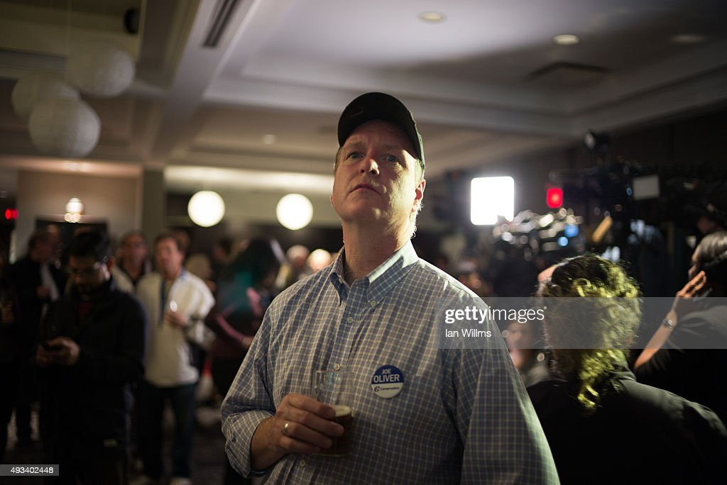 Dan Miles, campaign manager for former Finance Minister Joe Oliver watches as elections results come in at Oliver's election night reception, October 19, 2015 in Toronto, Canada. Oliver lost his seat to Liberal Marco Mendicino. Canadians went to the polls on October 19th and ousted Prime Minister Stephen Harper in favour of Justin Trudeau's Liberal party.