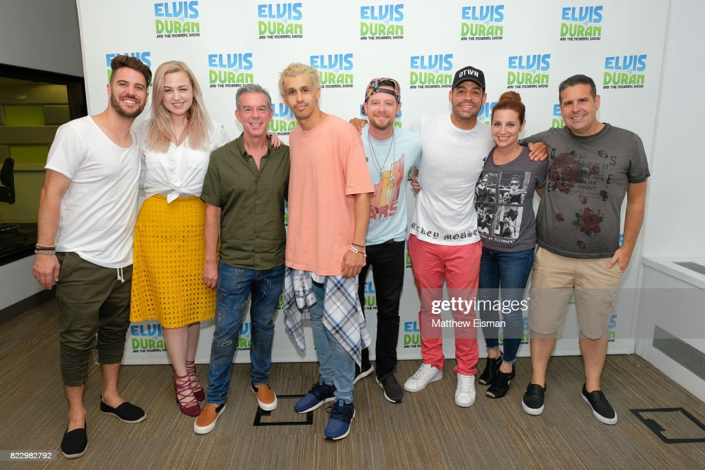 Dan Miller, Bethany Watson, Elvis Duran, Erik-Michael Estrada, Jacob Underwood Trevor Penick, Danielle Monaro and Skeery Jones pose together for a photo on 'The Elvis Duran Z100 Morning Show' at Z100 Studio on July 24, 2017 in New York City.