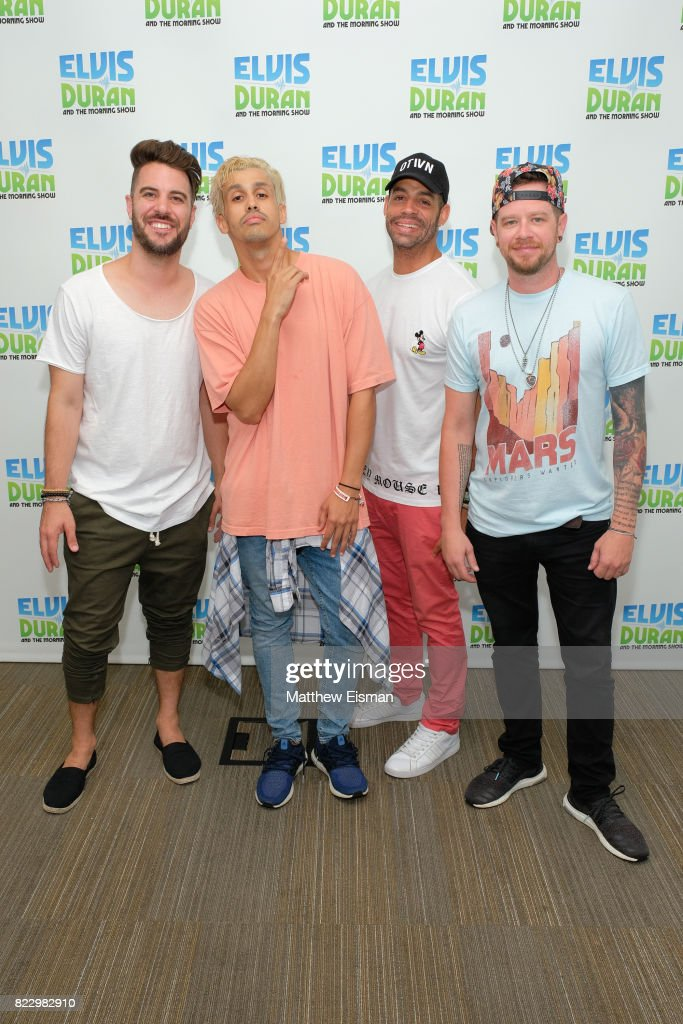 Dan Miller, Erik-Michael Estrada, Trevor Penick and Jacob Underwood of the band O-Town pose together for a photo on 'The Elvis Duran Z100 Morning Show' at Z100 Studio on July 24, 2017 in New York City.