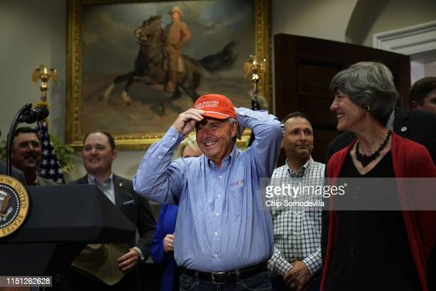 Dan Moss of the National Potato Council dons his 'Make Potatoes Great Again' hat before joining US President Donald Trump in the Roosevelt Room at...