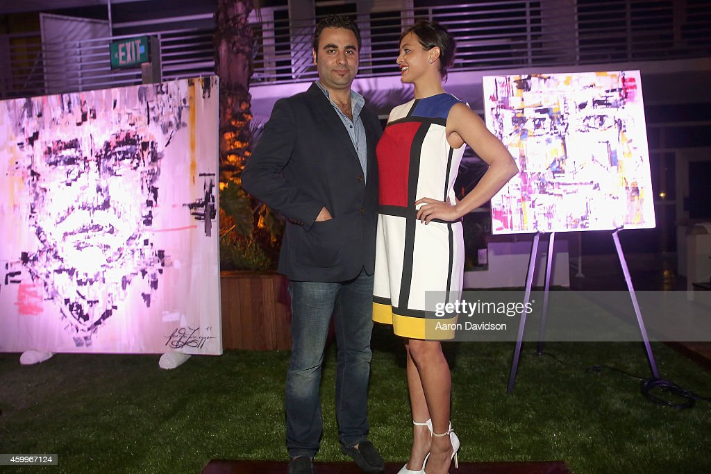 Dan Mounir (L) attends Sara Von Kienegger and Art of Elysium Host Los Angeles Gallery MAMA's Presentation Of Ryan Heffington's 'Wading Games' With Osk And Music BANKS at Ritz Carlton South Beach on December 4, 2014 in Miami Beach, Florida.