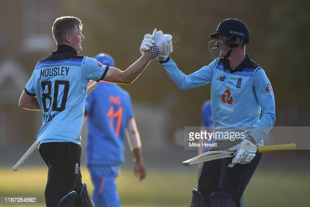 Dan Mousley and George Hill of England celebrate victory at the end of the Under 19 TriSeries match between England U19 and India U19 at the County...