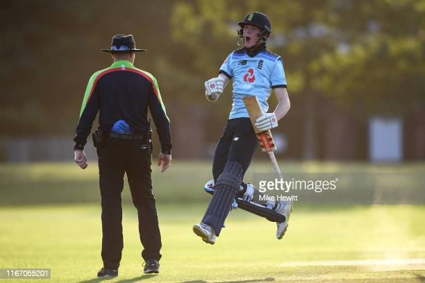 Dan Mousley of England celebrates after hitting the winning runs during an Under 19 TriSeries match between England U19 and India U19 at the County...