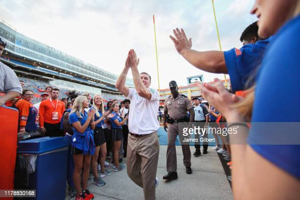 Dan Mullen head coach of the Florida Gators greets fans after a game against the Towson Tigers at Ben Hill Griffin Stadium on September 28 2019 in...