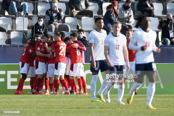 Dan Ndoye of Switzerland celebrates with teammates after scoring their team's first goal during the 2021 UEFA European Under-21 Championship Group D...