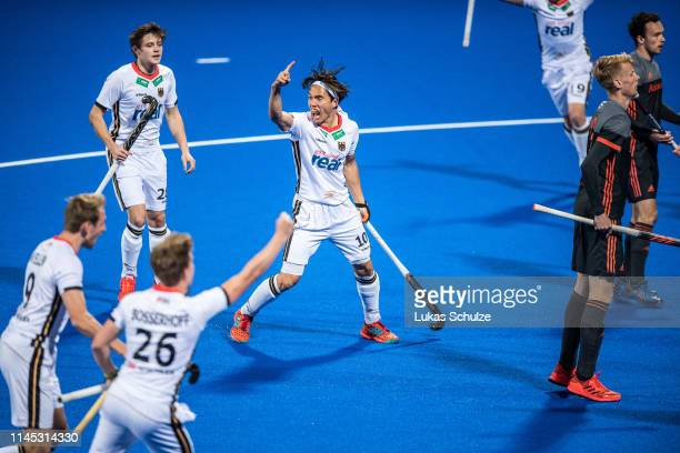 Dan Nguyen and team mates of Germany celebrate their team's first goal during the Men's FIH Field Hockey Pro League match between Germany and...