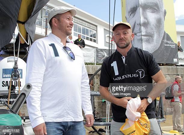 Dan Nicol presenting newly announced ambassador Ian Walker with a Laureus shirt during the Laureus Abu Dhabi Ocean Racing on November 15 2014 in Cape...