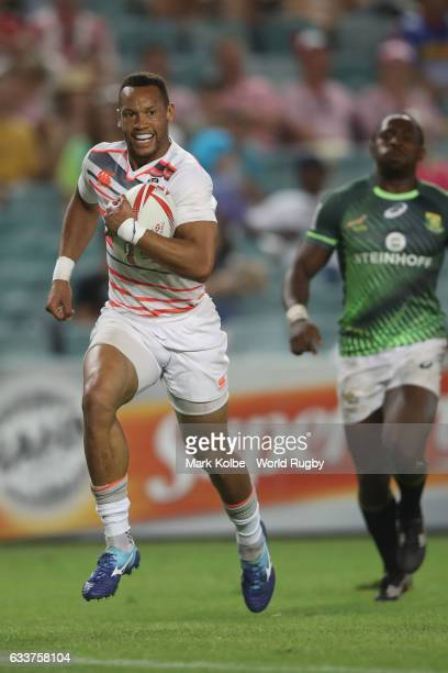 Dan Norton of England breaks away to score a try during the Mens Pool A match between South Africa and England in the 2017 HSBC Sydney Sevens at...