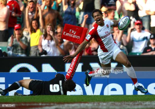 Dan Norton of England celebrates after crossing the line for a try in the IRB London Sevens final match between England and New Zealand during day...