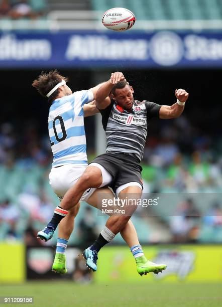Dan Norton of England collides with Felipe del Mestre of Argentina in the quarter final match during day three of the 2018 Sydney Sevens at Allianz...