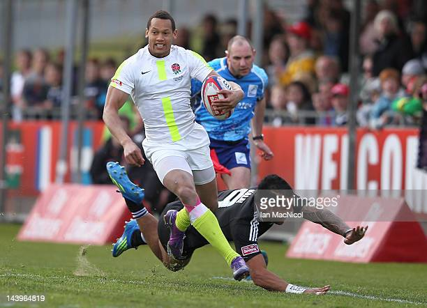 Dan Norton of England evades being tackled by Frank Halai of New Zealand during the match between New Zealand and England during day two of the IRB...