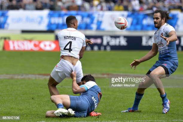 Dan Norton of England is tackled by Jeremy Aicardi of France during the HSBC rugby sevens match between France and England on May 13 2017 in Paris...