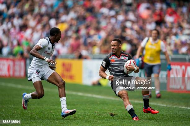 Dan Norton of England is tackled during the 2017 Hong Kong Sevens match between USA and England at Hong Kong Stadium on April 9 2017 in Hong Kong...