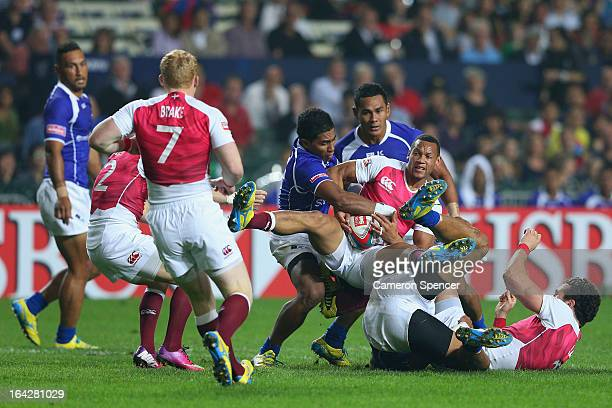 Dan Norton of England is tackled during the Pool C match between England and Samoa during day one of the 2013 Hong Kong Sevens at Hong Kong Stadium...