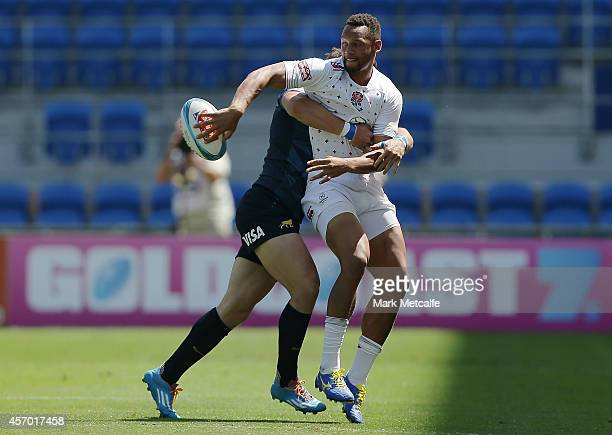 Dan Norton of England looks to offload from a tackle during the 2014 Gold Coast Sevens Pool D match between England and Argentina at Cbus Super...