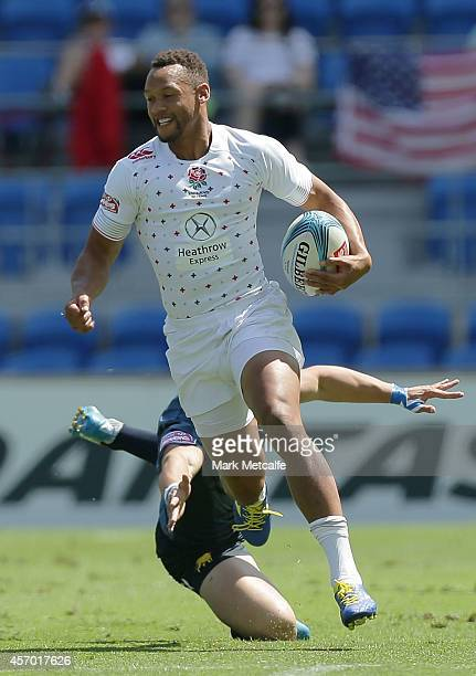 Dan Norton of England makes a break to score a try during the 2014 Gold Coast Sevens Pool D match between England and Argentina at Cbus Super Stadium...