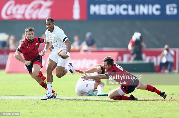 Dan Norton of England runs in a try against Wales during the Emirates Dubai Rugby Sevens HSBC Sevens World Series at The Sevens Stadium on December 4...